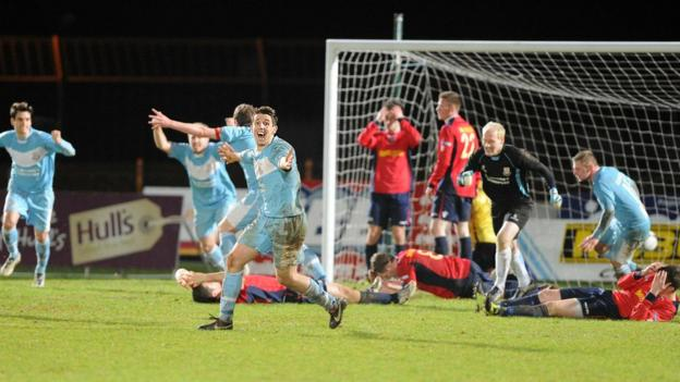 Ballymena United players, including keeper Dwayne Nelson, start their celebrations after Mark Surgenor's last-gasp goal secures a 3-3 draw with Lisburn Distillery
