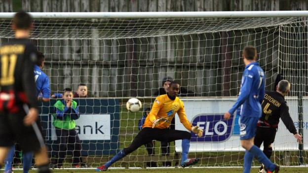 Gary McCutcheon sends Ballinamallard United keeper Alvin Rouse the wrong way with his penalty to equalise in the 3-1 victory for Crusaders
