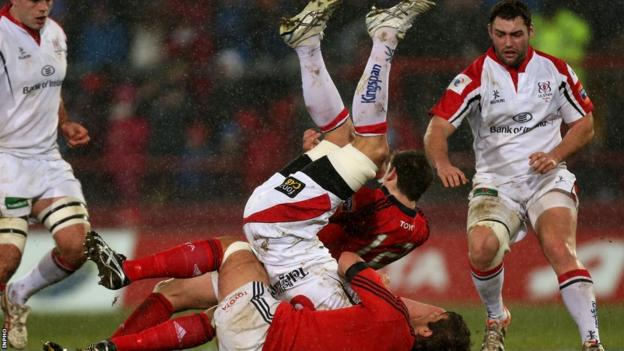 Robbie Diack is tackled by Munster's James Downey