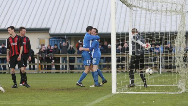Stehen Feeney celebrates with goalscorer David Kee after Ballinamallard United take the lead against Crusaders at Ferney Park