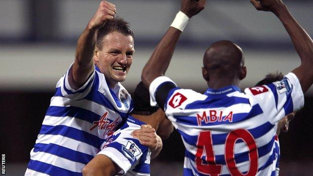 Clint Hill (left) celebrates the win over Fulham