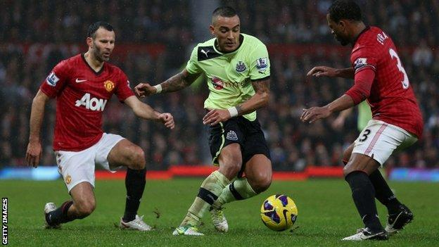 Danny Simpson of Newcastle United moves between Ryan Giggs and Patrice Evra