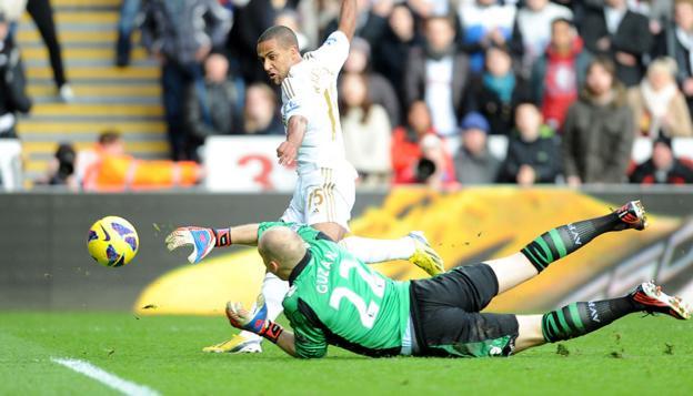 Wayne Routledge steers the ball past Brad Guzan to give Swansea City the lead again Aston Villa at the Liberty Stadium.