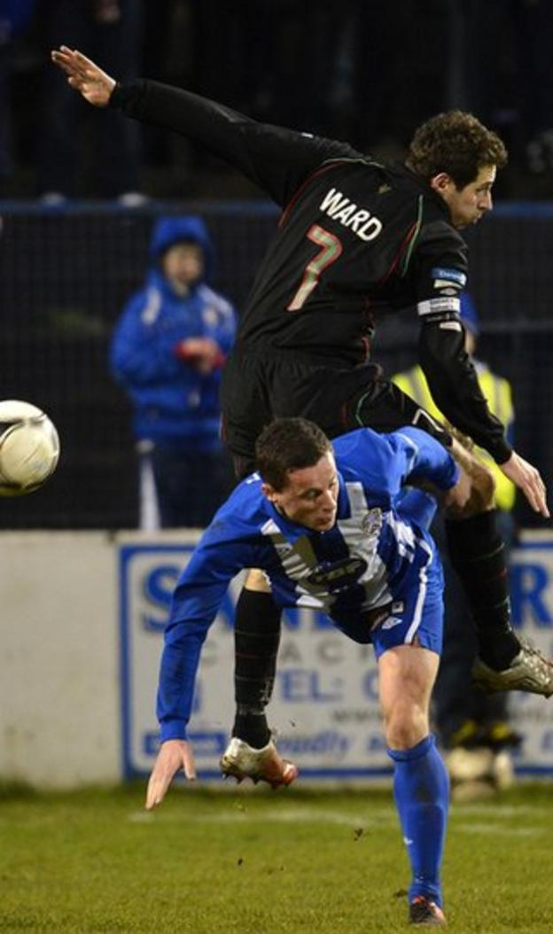 Glentoran defender Sean Ward leaps above Ruairi Harkin in the 1-1 draw with Coleraine