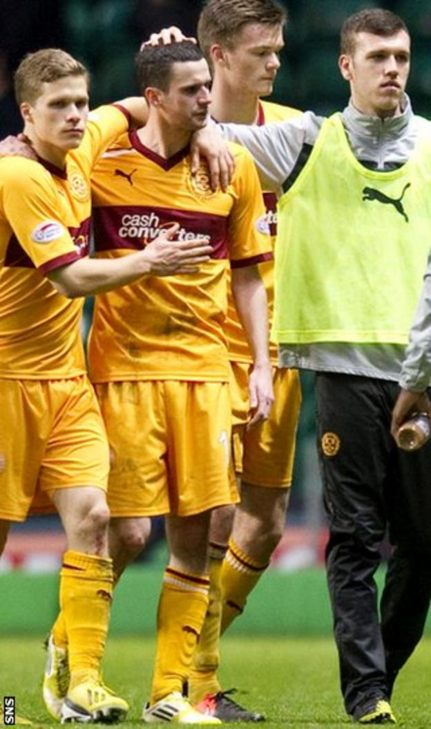 Henrik Ojamaa consoles Jamie Murphy at the final whistle at Celtic Park