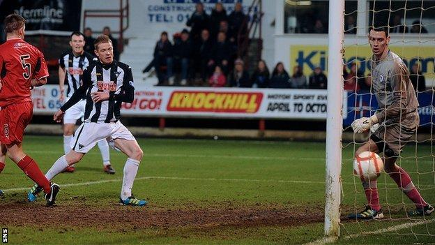 Andrew Geggan scores for Dunfermline against Raith Rovers