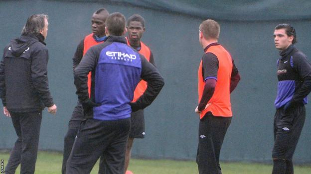 Roberto Mancini (far left) and Mario Balotelli (second from left)