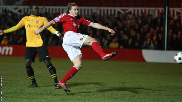 Danny Wright scores Wrexham's opener in the Blue Square Bet Premier at Newport County