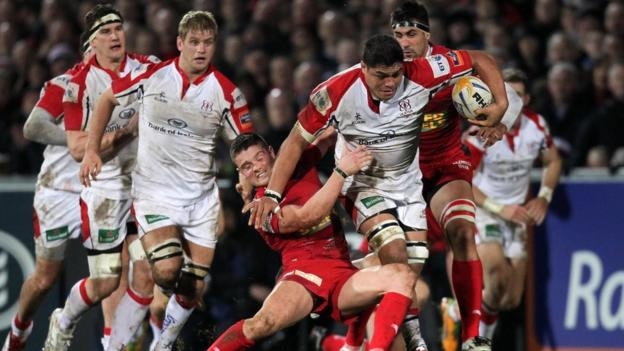Tavis Knoyle of Scarlets attempts to halt a powerful charge by Ulster number eight Nick Williams at Ravenhill