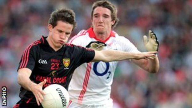 Paul McComiskey battles with Aidan Walsh in the 2011 All-Ireland qualifier