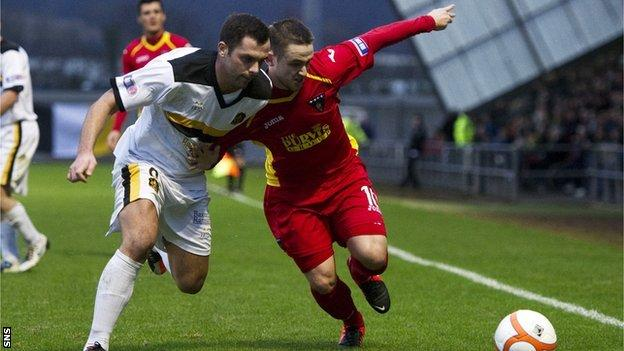 Dumbarton's Chris Turner vies for possession with Ryan Wallace