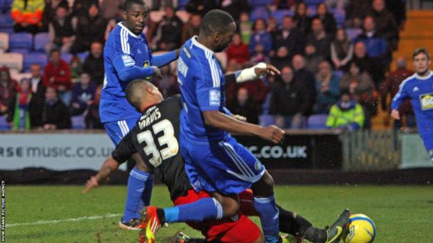 Nat Jarvis slides in at the far post to give Cardiff City the lead in their FA Cup third round tie at Conference side Macclesfield