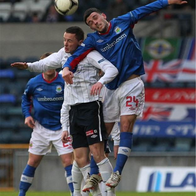 Ruairi Harkin of Coleraine and Linfield's Brian McCaul go up for a high ball during the Irish Premiership match at Windsor Park