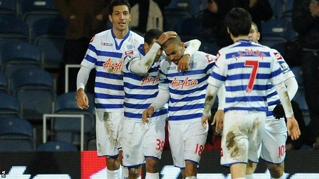 Kieron Dyer (centre) is congratulated by his QPR team-mates after scoring the equaliser against West Brom