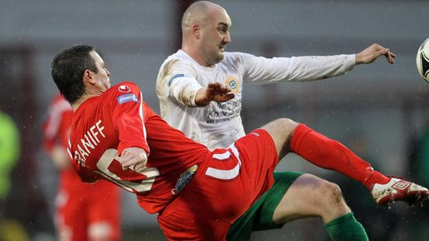 Portadown skipper Kevin Braniff and Paul McAreavey of Donegal Celtic battle for possession
