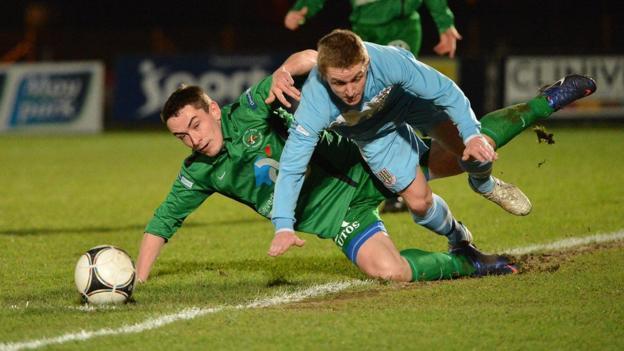 Chris Curran of Ballinamallard in action against Ballymena United's Ally Teggart