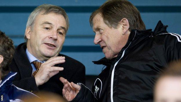 Uefa general secretary David Taylor (left) chats with Livingston chairman Gordon McDougall