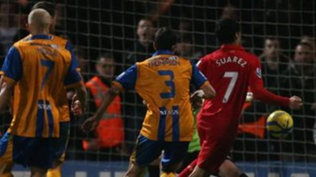 Luiz Suarez turns in the winner for Liverpool against Mansfield