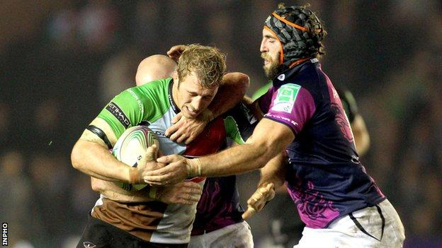 Chris Robshaw is tackled by Adrian Flavin and John Muldoon during the game in October