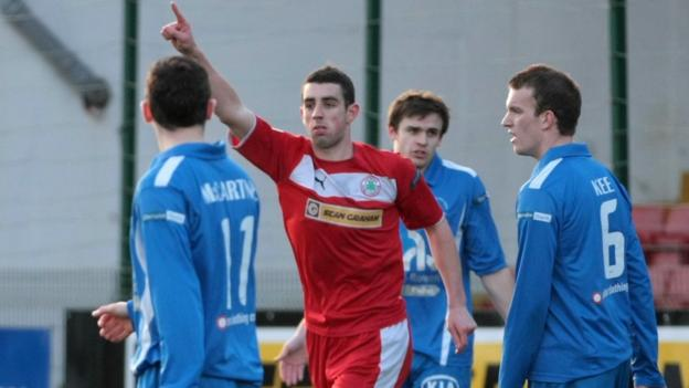 Cliftonville forward Joe Gormley celebrates after netting one of his two goals against Ballinamallard United at Solitude