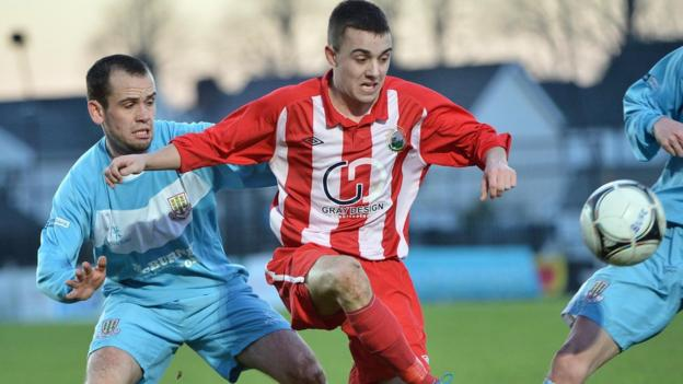 Tony Kane puts pressure on Warrenpoint's Ruairi Devlin during the 2-1 win for the Sky Blues