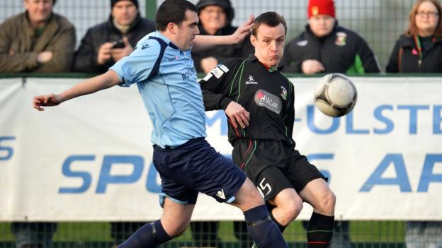 Killymoon's Steven Burns and Jason Hill in a race for the ball in Glentoran's 4-1 victory