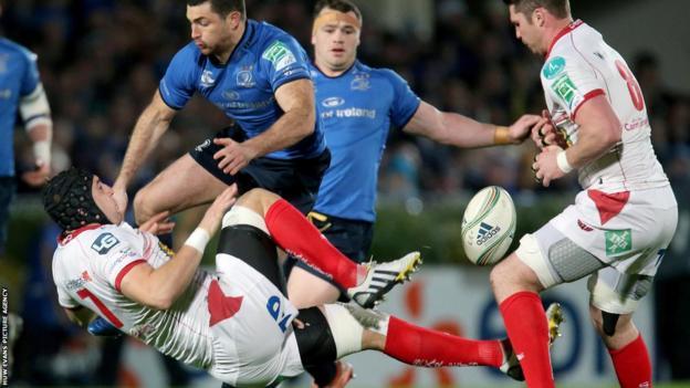 Scarlets flanker Josh Turnbull and Leinster full-back Rob Kearney collide