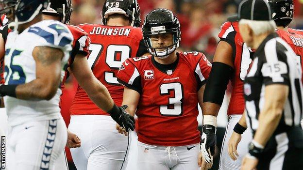 Matt Bryant (centre) is congratulated for kicking the winning field goal for the Atlanta Falcons