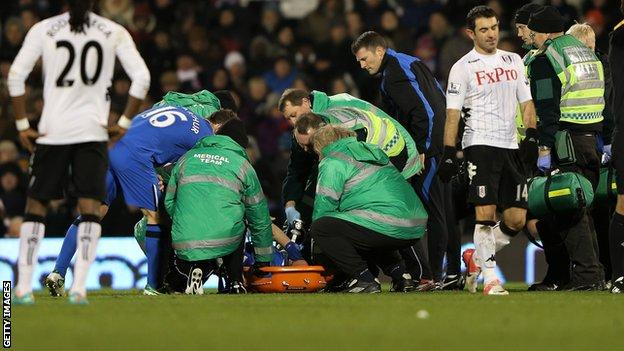 Wigan Athletic defender Ivan Ramis receives treatment for his knee injury at Fulham