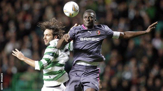 Kader Mangane (right) challenges Celtic's Georgios Samaras