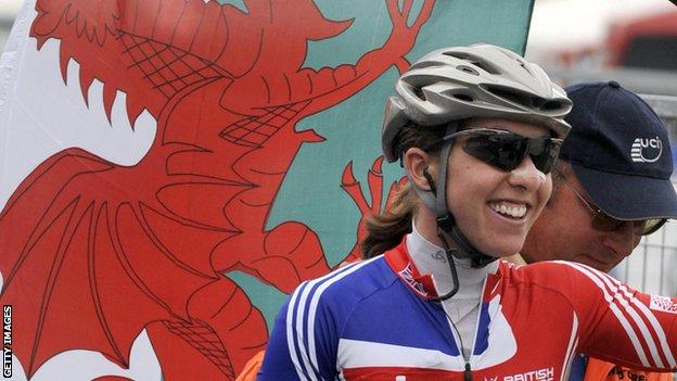 Nicole Cooke with a Welsh flag