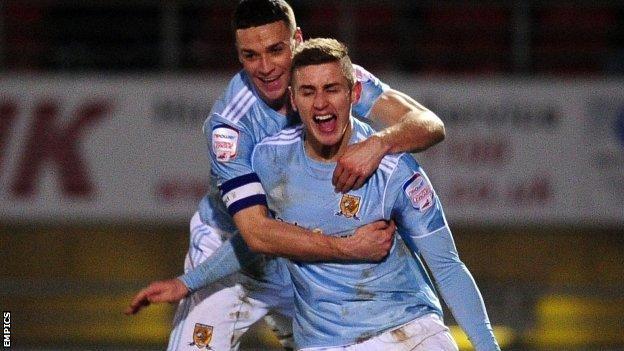 Tom Cairney (right) celebrates scoring the winning goal for Hull