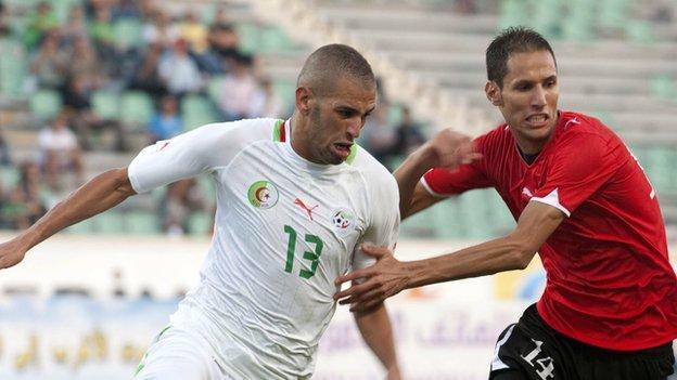 Islam Slimani (left)