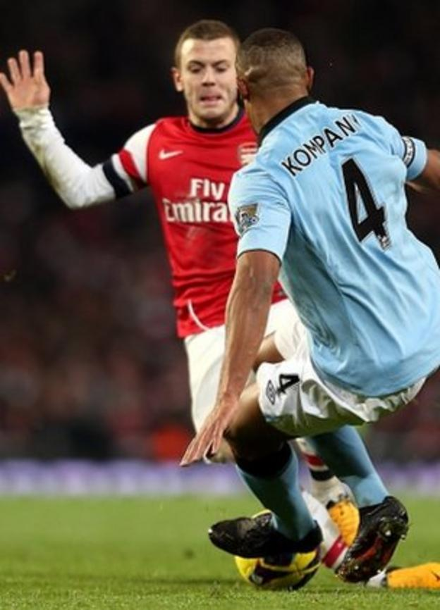 Vincent Kompany's challenge on Jack Wilshere earned a red card