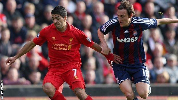 Luis Suarez and Dean Whitehead