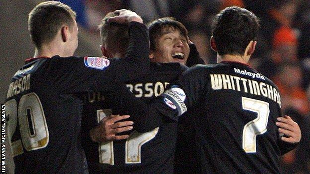 Cardiff City celebrate their opening goal at Blackpool