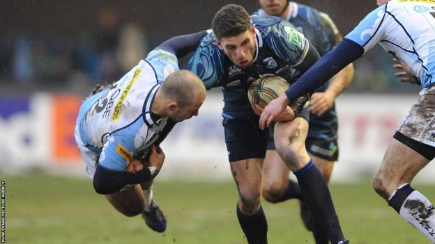 Mark Jennings takes the aerial approach in his attempt to pull down Blues wing Alex Cuthbert