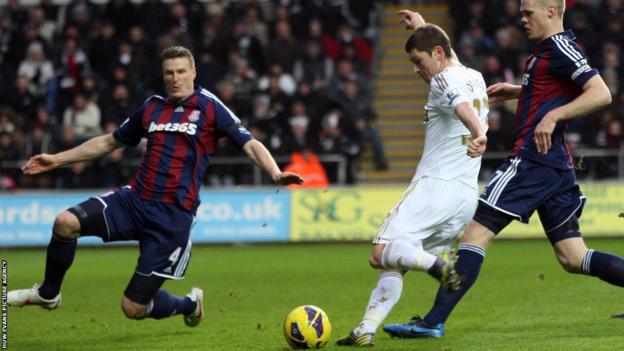Ben Davies' shot puts Swansea into the lead against Stoke