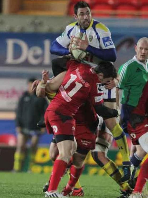 Scarlets wing Kristian Phillips lifts Clermont Auvergne opponent Julien Malzieu off the floor