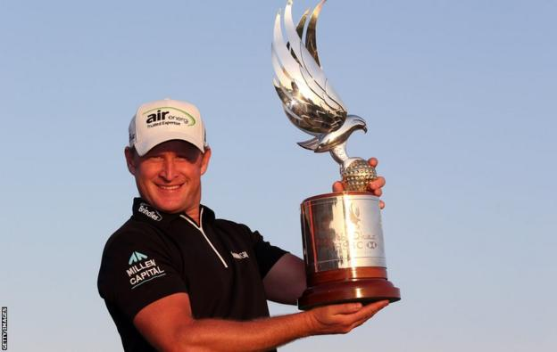 Jamie Donaldson poses with the Abu Dhabi Championship trophy after overhauling Justin Rose's two-stroke lead to win by one shot.