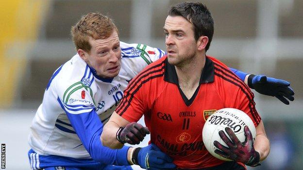 Monaghan's Kieran Hughes battles with Down's Mark Poland