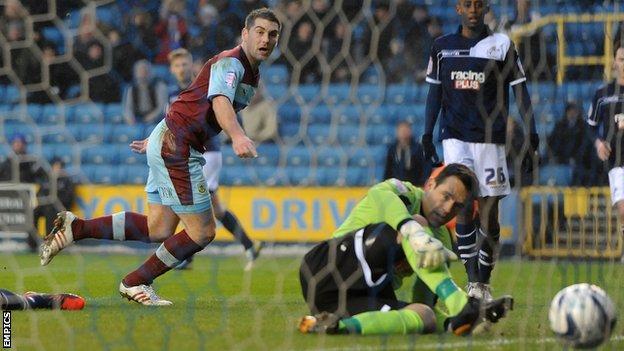 Sam Vokes heads Burnley ahead at Millwall on Saturday