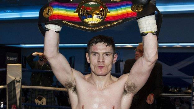 Willie Limond holds aloft the Commonwealth light welterweight belt