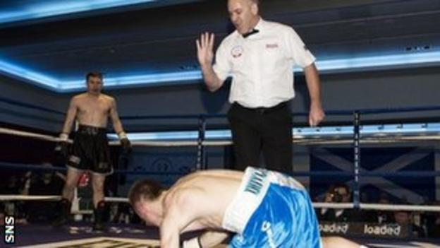 Eddie Doyle struggles to get back on his feet after his second knockdown by Willie Limond