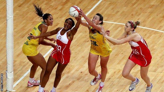Pamela Cookey of England beats Rebecca Bulley of Australia to the ball