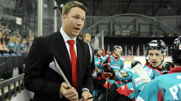 Belfast Giants coach Doug Christiansen talks to his players players during the 6-2 defeat by the Braehead Clan in the Elite League game at the Odyssey Arena