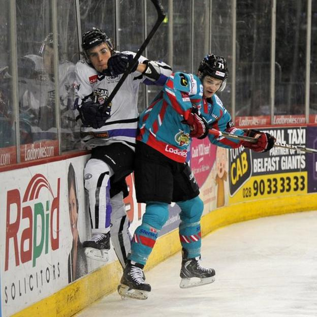 Craig Peacock of the Belfast Giants checks Davide Nicoletti of the Braehead Clan