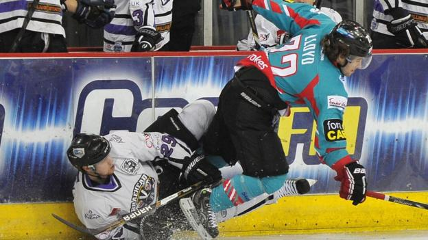 Darryl Lloyd of the Belfast Giants checks Adam Walker of the Braehead Clan during the Elite League game