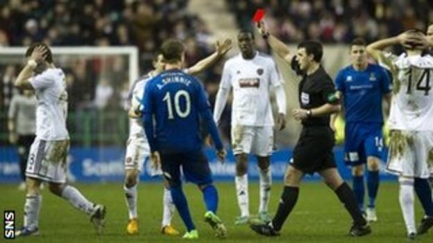 Referee Euan Norris sends off Hearts' Scott Robinson