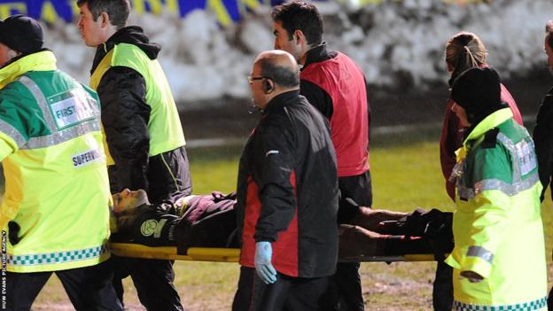 Dragons wing Mike Poole is carried off the field after suffering an ankle injury during the opening minutes of his side's LV=Cup game against Ospreys at Rodney Parade.